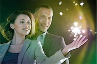 futuristic - Businesspeople reaching out to lights Stock Photo - Premium Royalty-Freenull, Code: 614-06169446