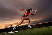 sprint - Female athlete moving off from starting blocks Stock Photo - Premium Royalty-Freenull, Code: 614-06169456