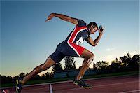 runner (male) - Male athlete leaving starting blocks Stock Photo - Premium Royalty-Freenull, Code: 614-06169463