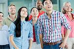 Group of people looking up Stock Photo - Premium Royalty-Freenull, Code: 614-06169526