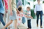 Mother hugging children at airport Stock Photo - Premium Royalty-Free, Artist: Minden Pictures, Code: 614-06169538