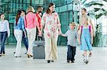 Mother and children walking through airport Stock Photo - Premium Royalty-Free, Artist: Ty Milford, Code: 614-06169547
