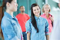 Young woman in crowd Stock Photo - Premium Royalty-Freenull, Code: 614-06169554