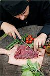 Cooking ingredients: marinated meat,oil,vinegar, herbs and vegetables. Chef is carving and marinating meat. Stock Photo - Royalty-Free, Artist: mythja                        , Code: 400-06170633