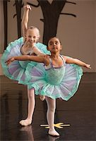 Two ballet students in fancy dresses posing together Stock Photo - Royalty-Freenull, Code: 400-06172148