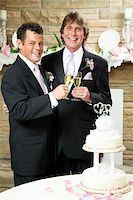 Gay couple giving champagne toast at their wedding reception. Stock Photo - Royalty-Freenull, Code: 400-06172881