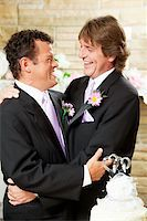 Gay male couple embracing on their wedding day. Stock Photo - Royalty-Freenull, Code: 400-06172884