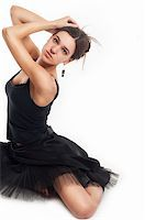 feet gymnast - female ballet dancer in black dress holding her hair isolated on white Stock Photo - Royalty-Freenull, Code: 400-06174530