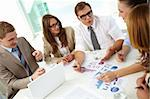 Image of confident partners sharing new ideas at meeting Stock Photo - Royalty-Free, Artist: pressmaster                   , Code: 400-06175601