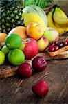 Organic Fruit variety on wood. Tropical exotic food concept. Stock Photo - Royalty-Free, Artist: mythja                        , Code: 400-06176139