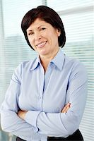 Mature businesswoman looking at camera with smile Stock Photo - Royalty-Freenull, Code: 400-06177694