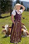 Young woman in a dirndl in an alpine meadow with cows enjoying the view Stock Photo - Royalty-Free, Artist: STphotography                 , Code: 400-06179944
