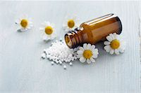 pharmaceutical plant - Chamomile and Homeopathic Medicine Stock Photo - Premium Royalty-Freenull, Code: 600-06180196