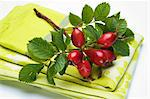 A sprig on rosehips on a dish cloth Stock Photo - Premium Royalty-Free, Artist: Jodi Pudge, Code: 659-06183646