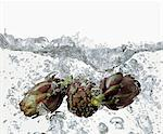 Artichokes in boiling water Stock Photo - Premium Royalty-Free, Artist: ableimages, Code: 659-06183763