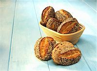Spelt rolls in a bread basket and next to it Stock Photo - Premium Royalty-Freenull, Code: 659-06184240