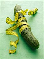 slim - A cucumber with tape measure on a green surface Stock Photo - Premium Royalty-Freenull, Code: 659-06184396