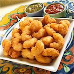 Fried Breaded Shrimp with Chili Sauce and Tomatillo Salsa Stock Photo - Premium Royalty-Freenull, Code: 659-06184675