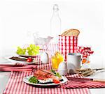 A table laid for breakfast with open sandwiches, egg and orange juice Stock Photo - Premium Royalty-Free, Artist: Aflo Relax, Code: 659-06184687