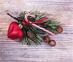 Pine sprig with Christmas decoration on a wooden surface Stock Photo - Premium Royalty-Freenull, Code: 659-06184849