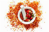 spicy - Dried chilli peppers and chilli flakes in a mortar Stock Photo - Premium Royalty-Freenull, Code: 659-06184925