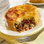 Individual Shepherds Pie with Bite Taken Out Stock Photo - Premium Royalty-Freenull, Code: 659-06185656