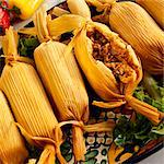 Serving Platter of Meat Filled Tamales; One Cut Open Stock Photo - Premium Royalty-Freenull, Code: 659-06185658