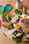 Salad with Arugula, Prosciutto, Fried Egg, Walnuts, Parmesan and Cheese Toasts Stock Photo - Premium Royalty-Free, Artist: Ikonica, Code: 659-06185908