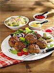 Meatballs with potato salad, mustard and ketchup Stock Photo - Premium Royalty-Freenull, Code: 659-06185955