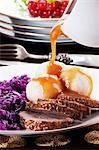 Roast goose with dumplings, red cabbage and gravy Stock Photo - Premium Royalty-Free, Artist: Blend Images, Code: 659-06186163