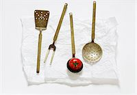Various old kitchen utensils and a tomato Stock Photo - Premium Royalty-Freenull, Code: 659-06186222