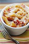 Individual Baked Penne with Tomatoes and Cheese; Fork Stock Photo - Premium Royalty-Free, Artist: Photocuisine, Code: 659-06186508