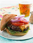 Cheeseburger with Lettuce, Tomato and Onion Stock Photo - Premium Royalty-Free, Artist: photo division, Code: 659-06186586