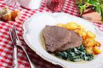 Boiled beef fillet with fried potatoes and spinach