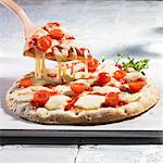 Pizza Margherita with tomato and mozzarella Stock Photo - Premium Royalty-Freenull, Code: 659-06186747
