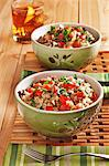 Two Bowls of Dirty Rice with Chopped Beef, Sausage, Tomatoes and Parsley Stock Photo - Premium Royalty-Freenull, Code: 659-06186790