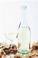 A bottle and a glass of wine with corks Stock Photo - Premium Royalty-Freenull, Code: 659-06187186