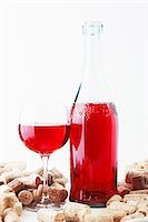 A bottle and a glass of wine and corks Stock Photo - Premium Royalty-Freenull, Code: 659-06187187