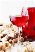 A bottle and a glass of wine and corks Stock Photo - Premium Royalty-Freenull, Code: 659-06187188