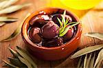Preserved olives in an earthenware bowl Stock Photo - Premium Royalty-Free, Artist: CulturaRM, Code: 659-06187285