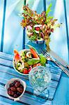 Two summer salads, olives and a glass of white wine Stock Photo - Premium Royalty-Free, Artist: Photocuisine, Code: 659-06187291