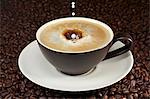 Milk dropping into coffee Stock Photo - Premium Royalty-Free, Artist: ableimages, Code: 659-06187471