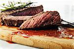 Sliced Steak on a Cutting Board with Juices Stock Photo - Premium Royalty-Free, Artist: Photocuisine, Code: 659-06187792