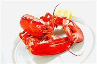 Boiled lobster with a slice of lemon Stock Photo - Premium Royalty-Freenull, Code: 659-06187845
