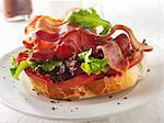 A slice of baguette topped with bacon, lettuce and tomato Stock Photo - Premium Royalty-Free, Artist: CulturaRM, Code: 659-06187942
