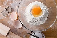Assorted baking ingredients, cookie cutters and rolling pin Stock Photo - Premium Royalty-Freenull, Code: 659-06188081