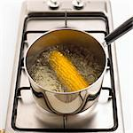 A corn cob being boiled Stock Photo - Premium Royalty-Free, Artist: Photocuisine, Code: 659-06188125