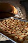Baked Baguette Slices on a Sheet Pan Coming Out of a Pizza Oven Stock Photo - Premium Royalty-Free, Artist: Cultura RM, Code: 659-06188167