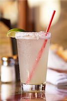 Margarita in a Glass with a Salted Rim and a Red Straw Stock Photo - Premium Royalty-Freenull, Code: 659-06188196