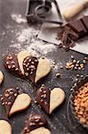 Heart-shaped biscuits with chocolate glaze and chopped nuts Stock Photo - Premium Royalty-Freenull, Code: 659-06188290